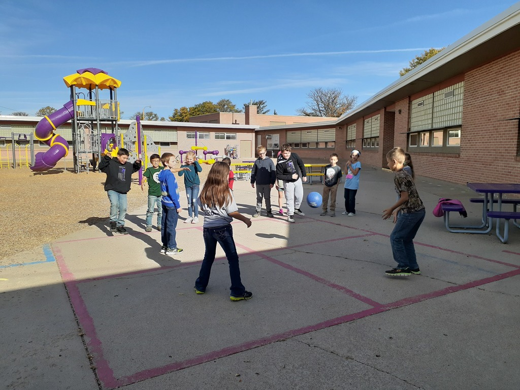 3rd Graders playing 4-Square with the ultimate goal of becoming King or Queen of the court.