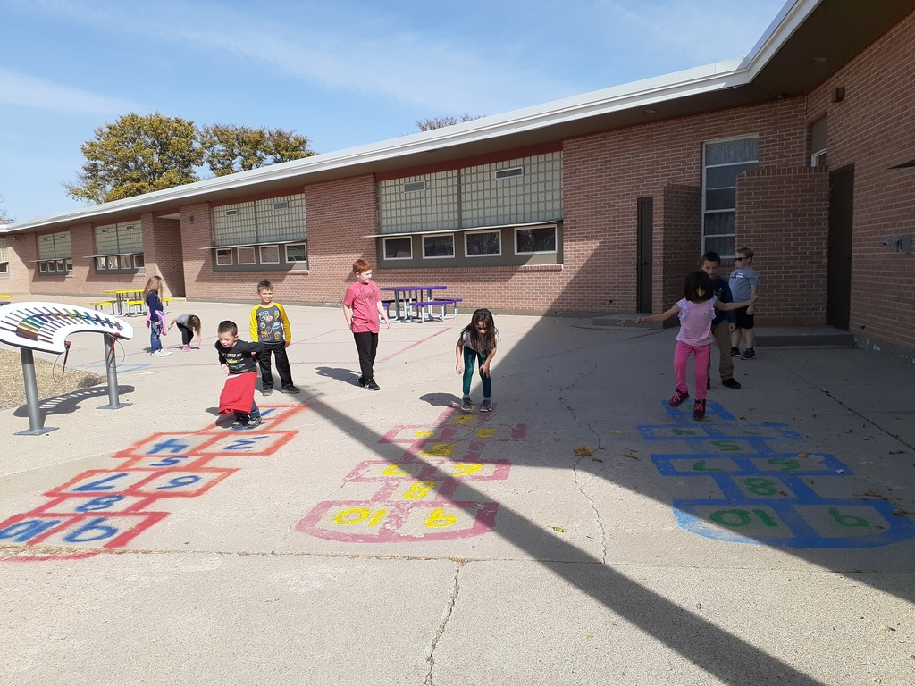 1st Graders competing in a good old fashioned game of Hopscotch.