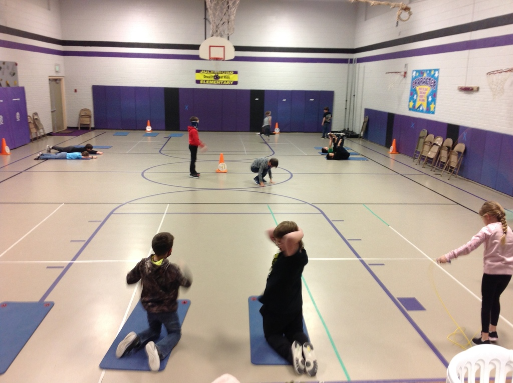 2nd Graders working hard at fitness stations on Fitness Friday.