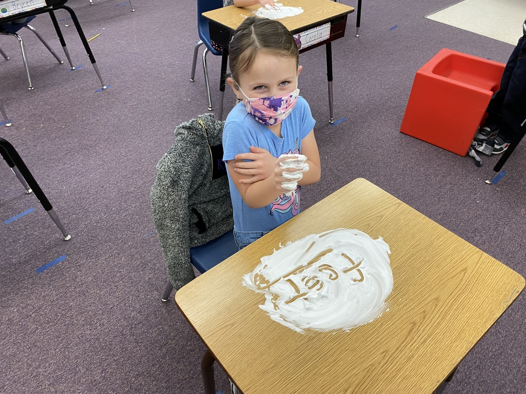 Practicing spelling words with shaving cream.