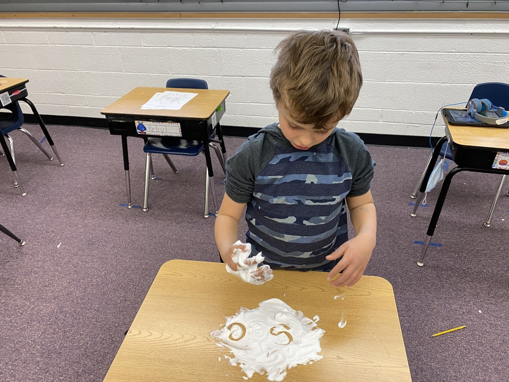 First graders practicing words with shaving cream.