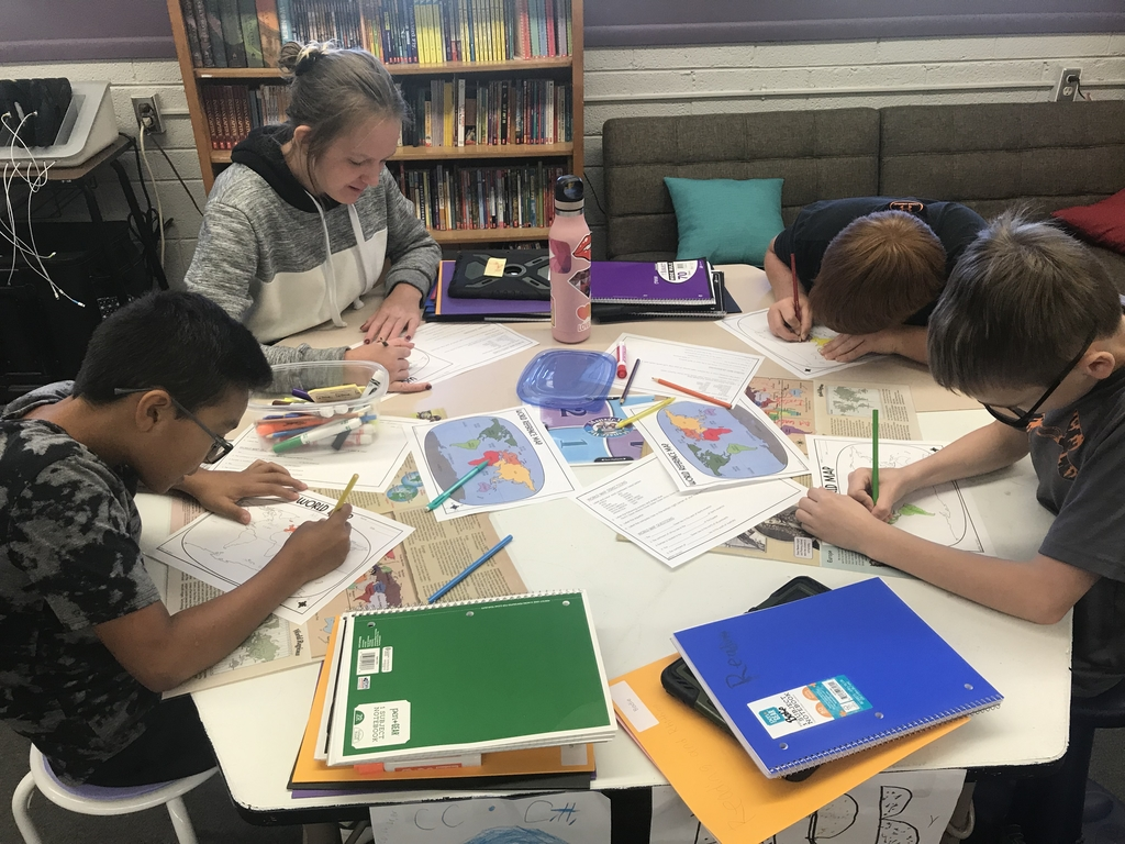After learning the regions of the world, they are coloring their maps