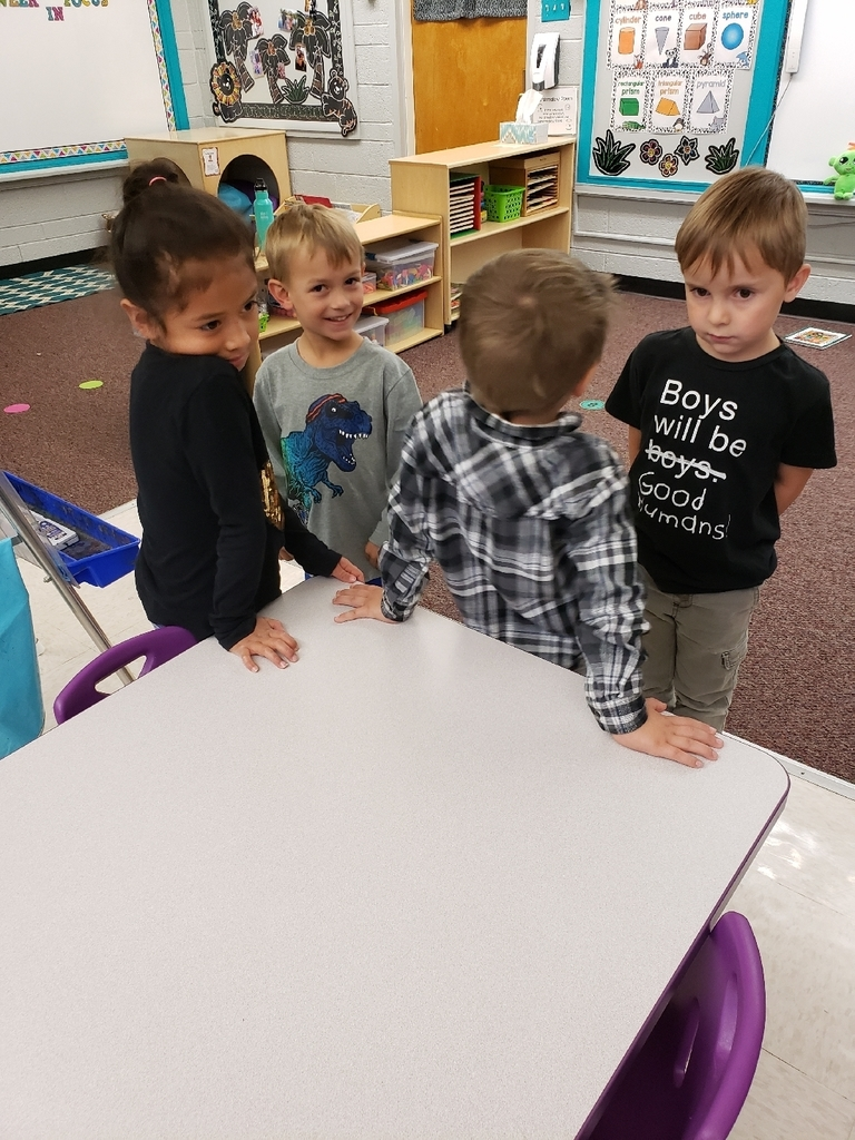 Preschool learning sharing square with Mrs. Dickey.