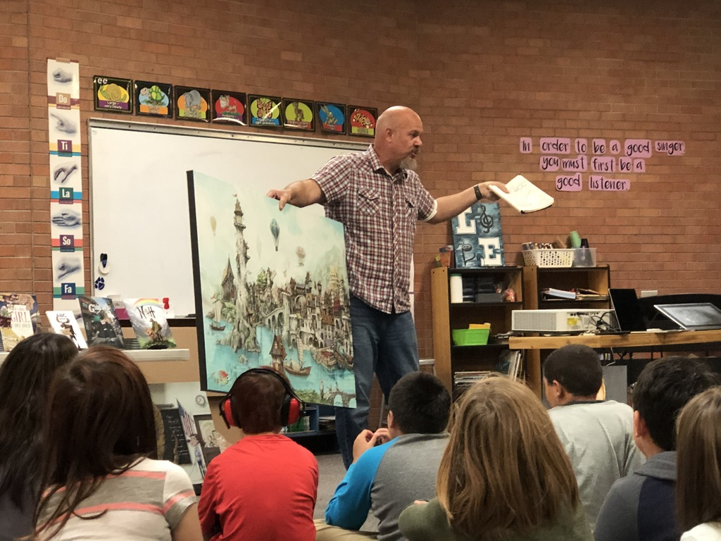 Mark Ludy teaching students about his artwork.