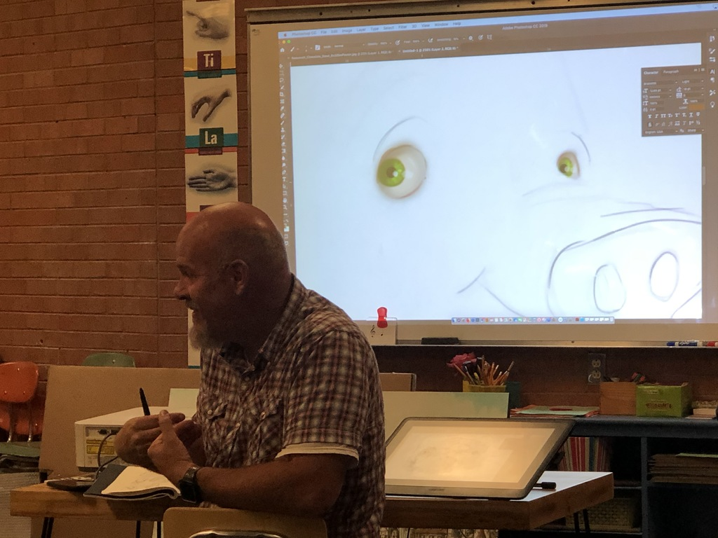 Mark Ludy teaching students about the use of photoshop.