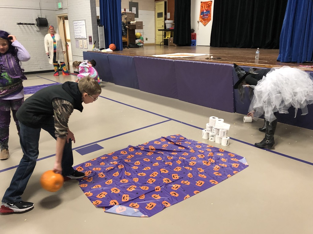Students pumpkin bowling.