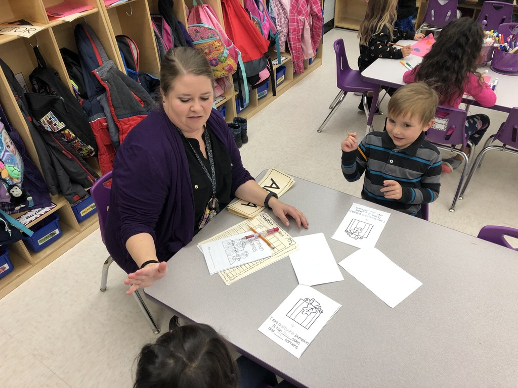 Preschool teacher Jourdin Wilson works with her small groups on shape identification.