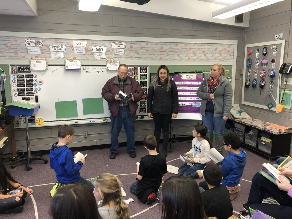 Rotary presenting dictionaries to 3rd grade students.