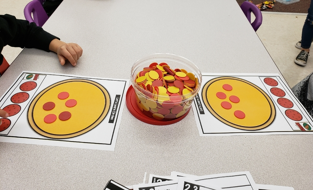 Pre-K learning about circles and subitizing.